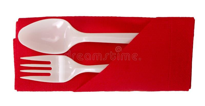 Plastic Lepel En Vork Op Geïsoleerdt Servet - Royalty-vrije Stock Afbeelding