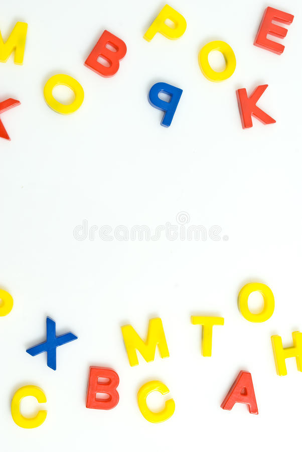 Plastic letters. Composition of many colorful plastic letters stock images