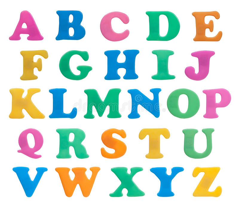 Plastic letters on white. Plastic magnetic alphabet letters isolated on white stock photography