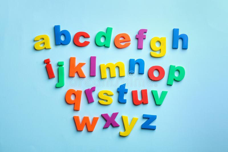 Plastic magnetic letters on color background, top view. Alphabetical order royalty free stock image