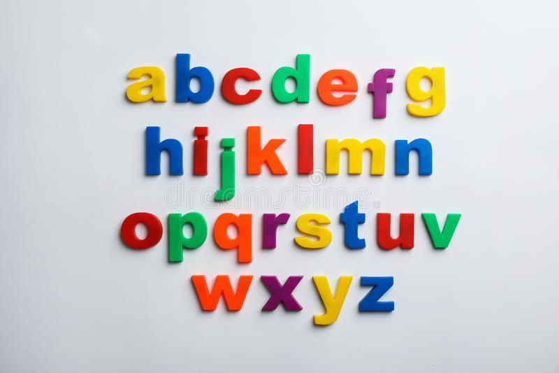 Plastic magnetic letters isolated on white, top view royalty free stock photo