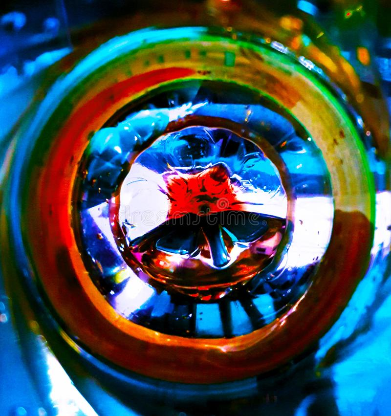 Plastic mandala in a bottle inside. There are wonders everywhere. In a plastic bottle is figurative secret geometry form from the universe stock photography
