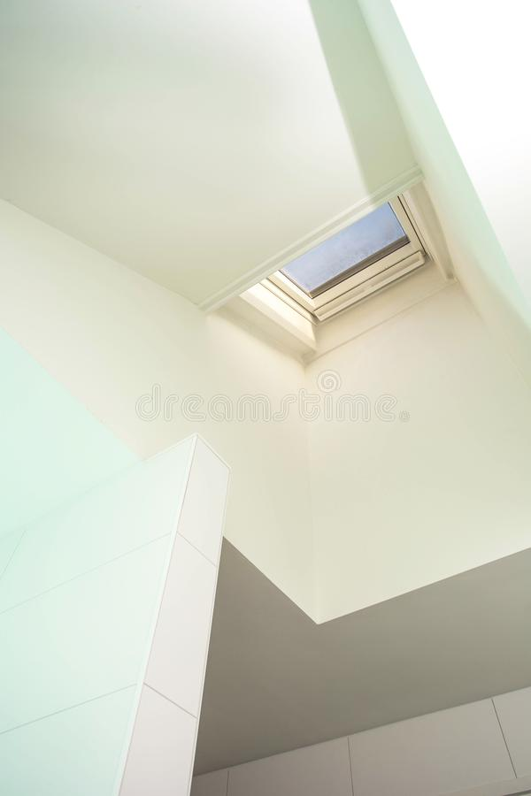 Plastic mansard or skylight window on attic with environmentally friendly and energy efficient thermal insulation stock image