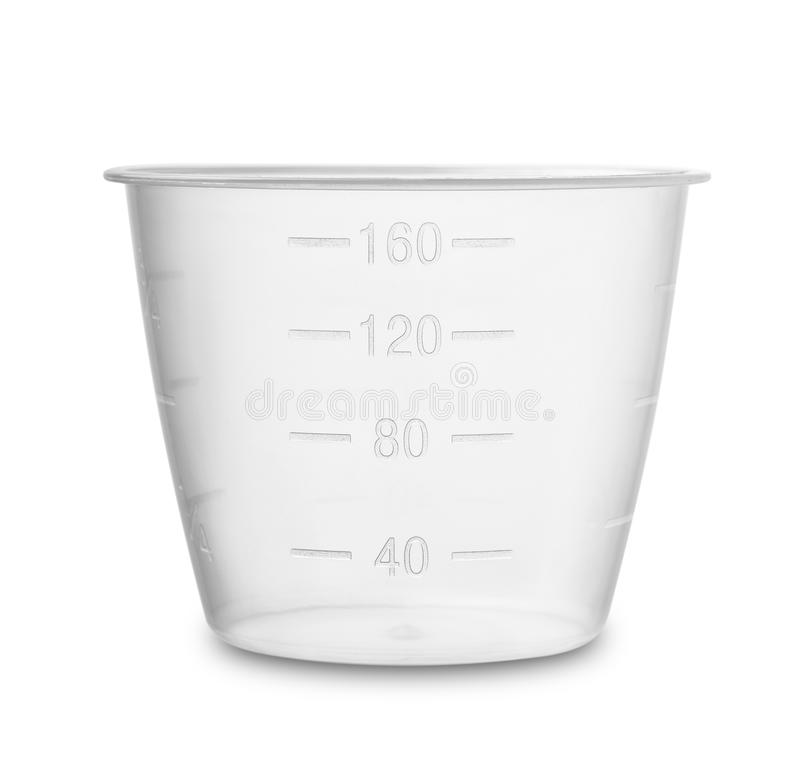 Plastic measuring cup. On white royalty free stock photography