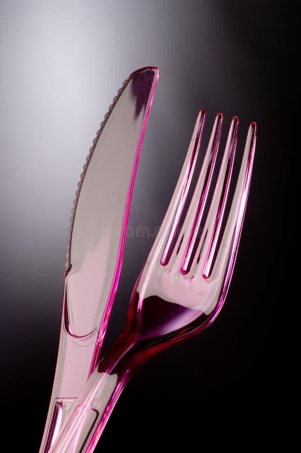 Plastic mes en vork stock foto's