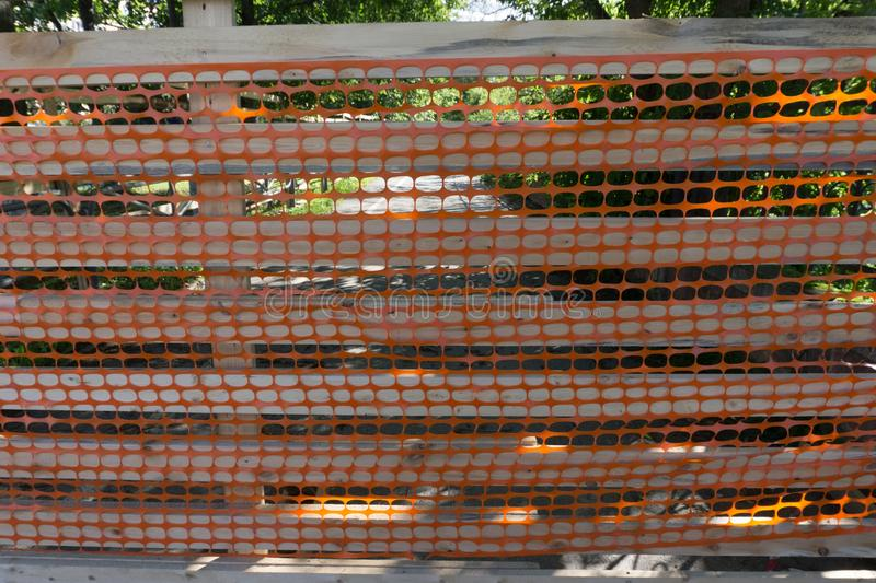 Plastic mesh for fencing. Emergency mesh. Background. royalty free stock photography