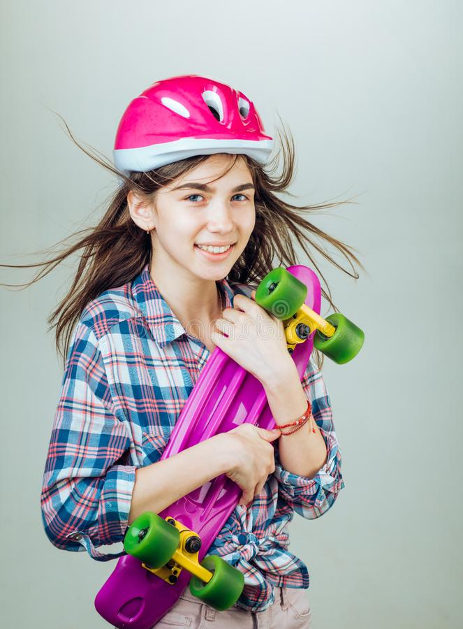 Plastic mini cruiser board. Spring. Urban scene, city life. Hipster girl with penny board. ready to ride on the street. Skateboard sport hobby. Summer activity royalty free stock photography