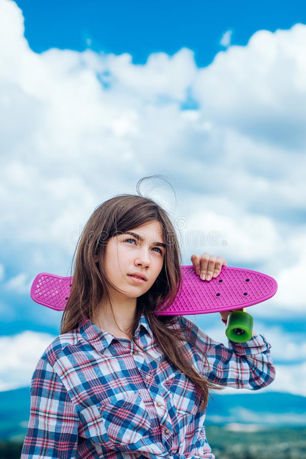 Plastic mini cruiser board. Spring. Urban scene, city life. ready to ride on the street. Hipster girl with penny board. Skateboard sport hobby. Summer activity royalty free stock images