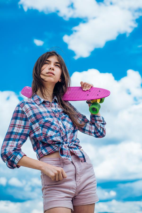 Plastic mini cruiser board. Spring. Urban scene, city life. skateboard sport hobby. Summer activity. ready to ride on. The street. Hipster girl with penny board royalty free stock photo