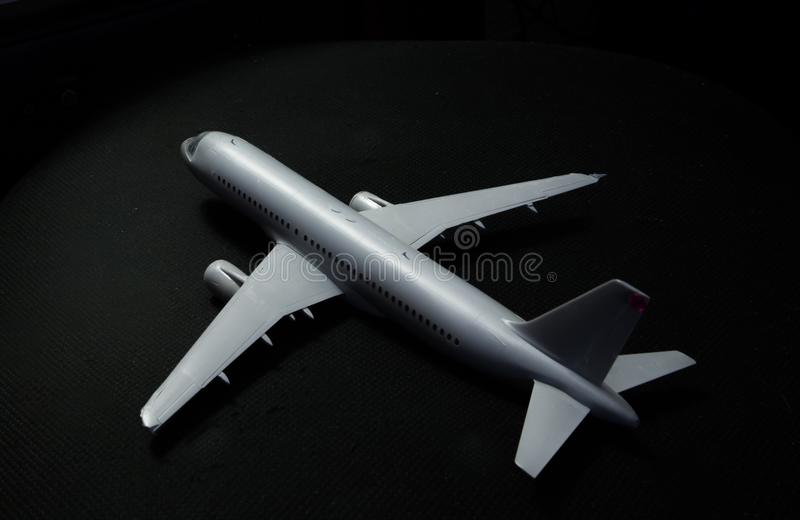 Night Aircraft. Plastic model of the Airbus 320 on a office chair. This photo make sense of flying jet in night sky royalty free stock photo
