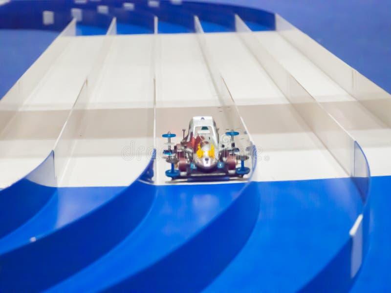 Plastic Model Scale Miniature racing Car running on lane track. A Plastic Model Scale Miniature racing Car running on lane track royalty free stock images