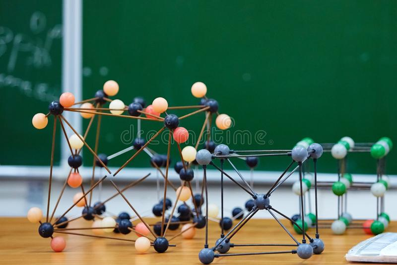 Plastic molecular educational model. On the background of the school board.  royalty free stock image