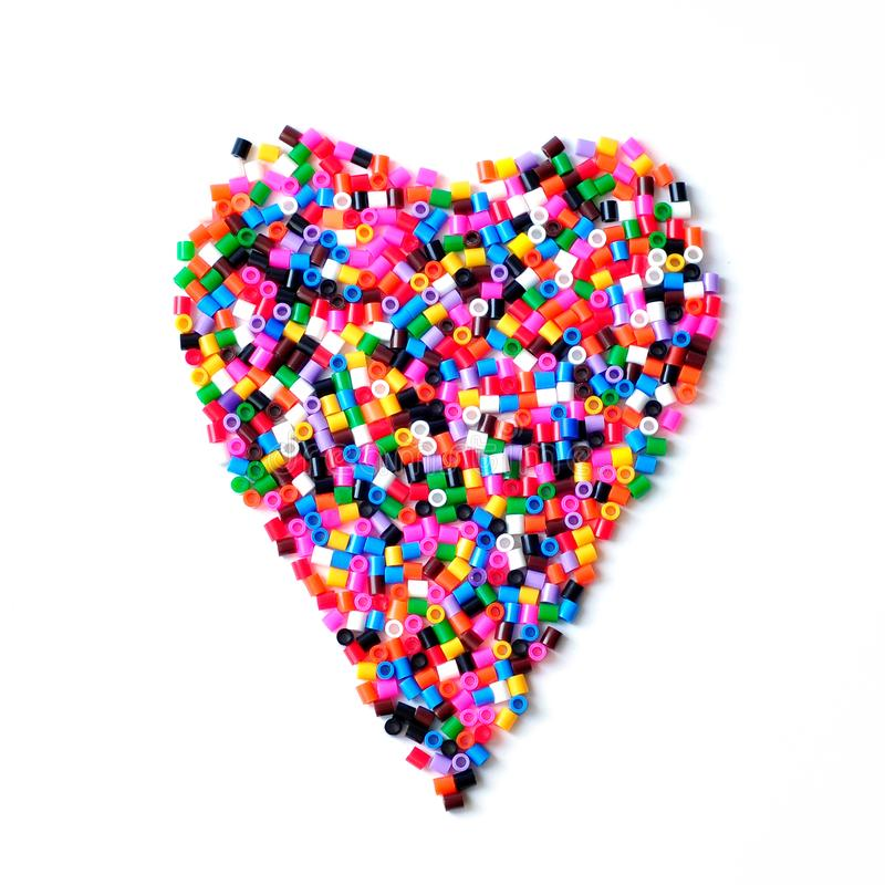 Plastic mosaic heart. Multi-colored childrens mosaic royalty free stock photography