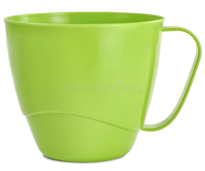 Plastic mug green on the table royalty free stock photos