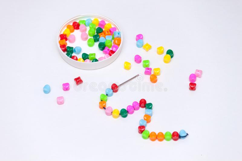 Plastic multicolored beads. Homemade game for children development concept royalty free stock photo