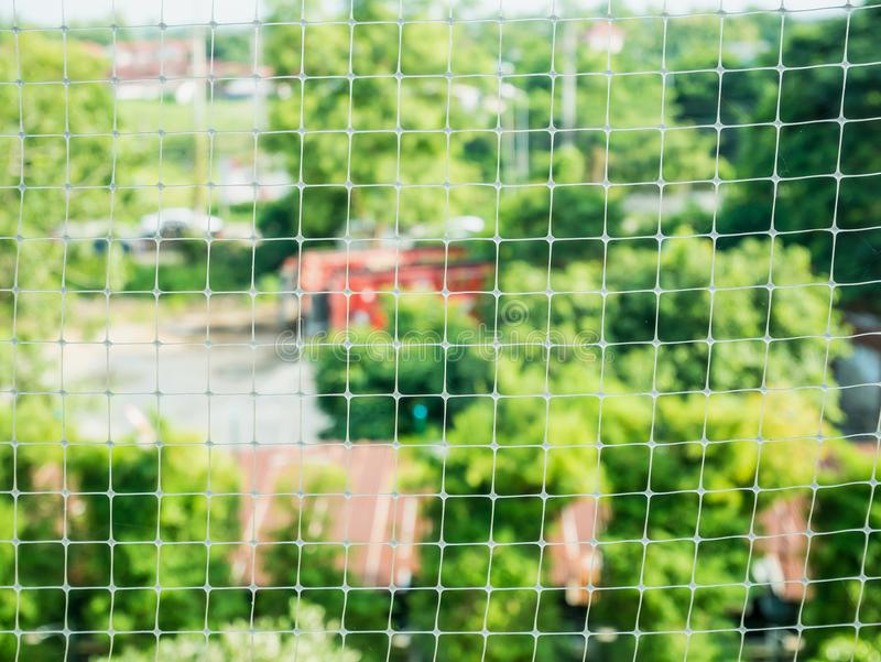 Plastic net with garden background stock images