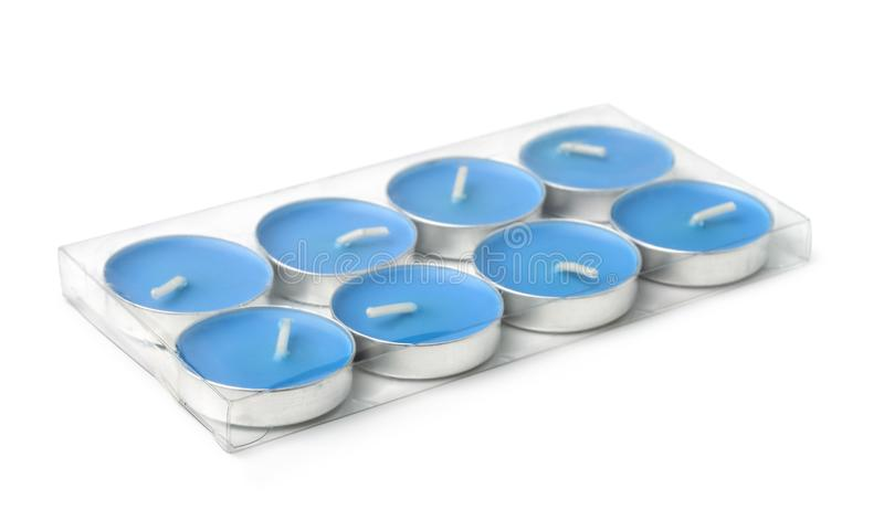 Plastic pack of tealight candles. Isolated on white stock images