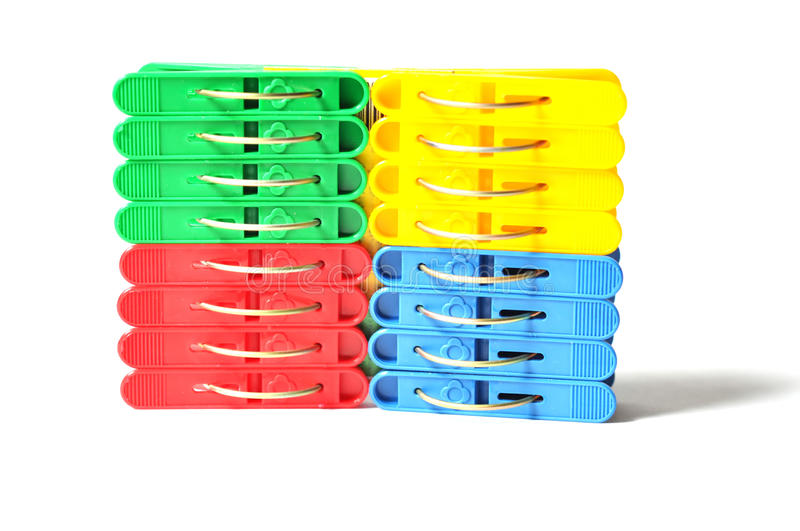 Plastic pegs in a set. On white with shadow stock images