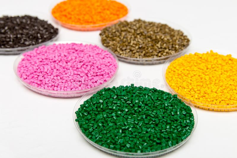 Plastic pellets .Polymeric dye в granules. The recycling of plastic. Granular colored plastic granules royalty free stock photos