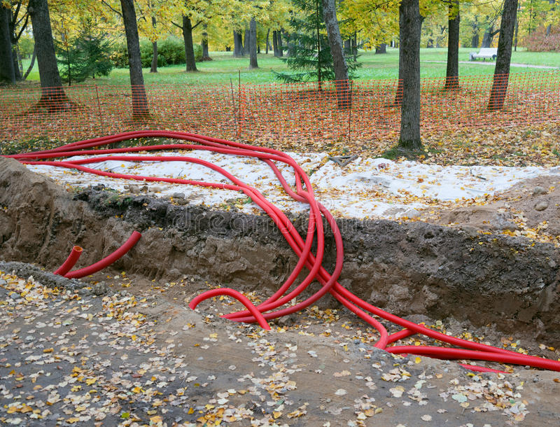 Plastic pipes containing electric cables stock images