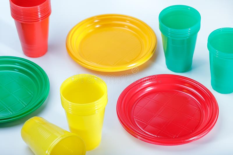 Plastic plates and cups on table royalty free stock photography