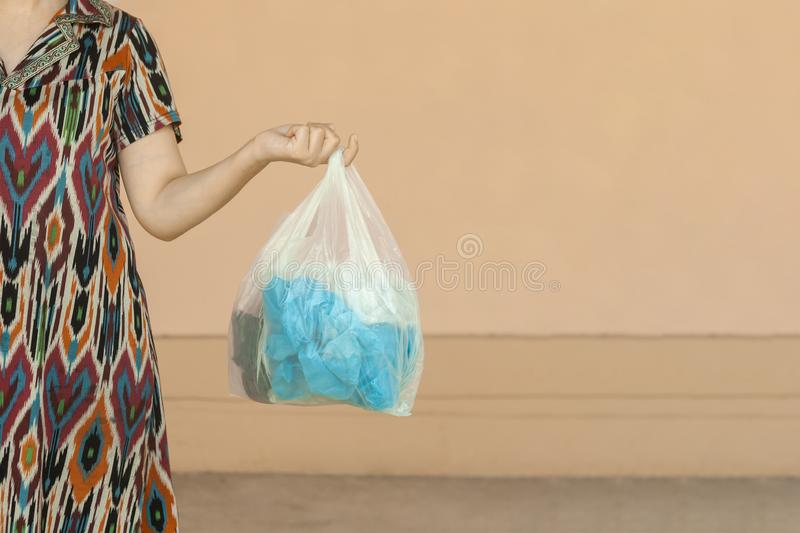 Plastic pollution. Female collected plastic bottles and holding recycling bin. Free space. Plastic pollution. Female collected plastic bottles and holding royalty free stock photos