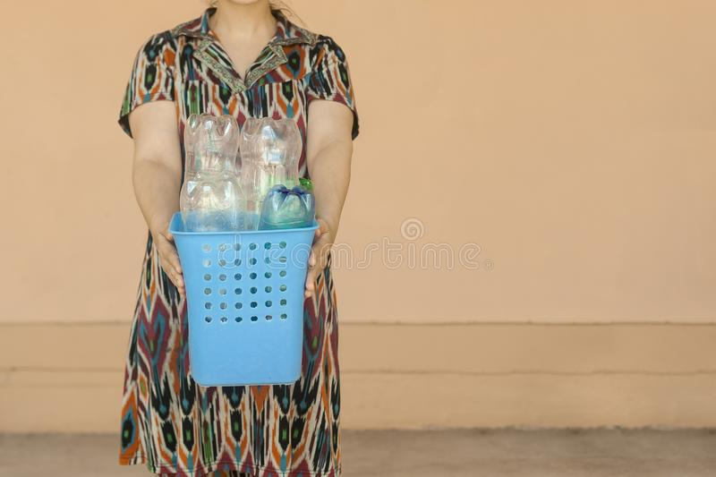 Plastic pollution. Female collected plastic bottles and holding recycling bin. Free space. Plastic pollution. Female collected plastic bottles and holding stock photo