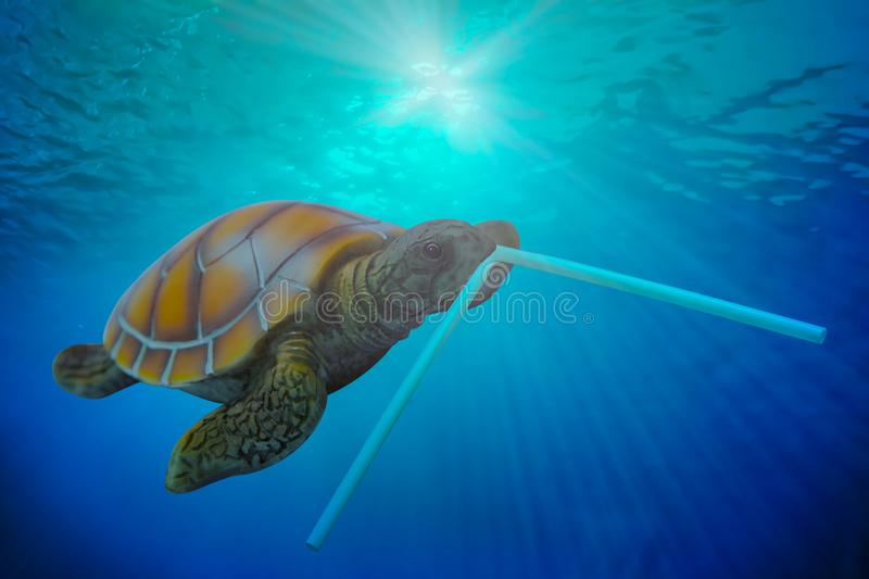 Plastic pollution in ocean environmental problem. Turtles can eat plastic tube mistaking them for food. Travel trips recreation. Sea. Cruise theme marine stock image