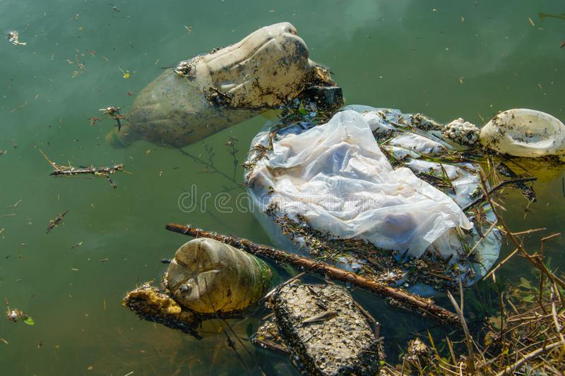 Plastic pollution in water. Ecological industry concept stock photography