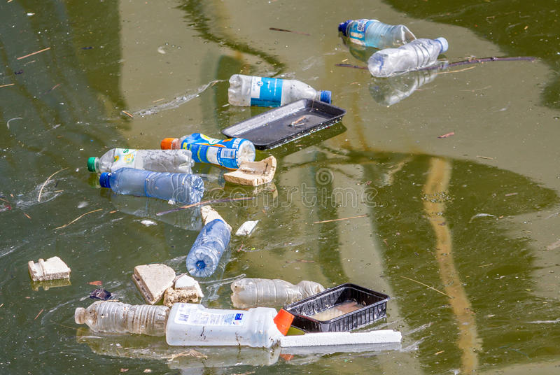 Plastic pollution in the water stock images