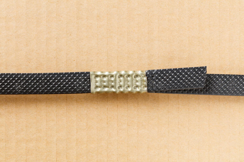 Plastic poly strap with metal clamp royalty free stock images