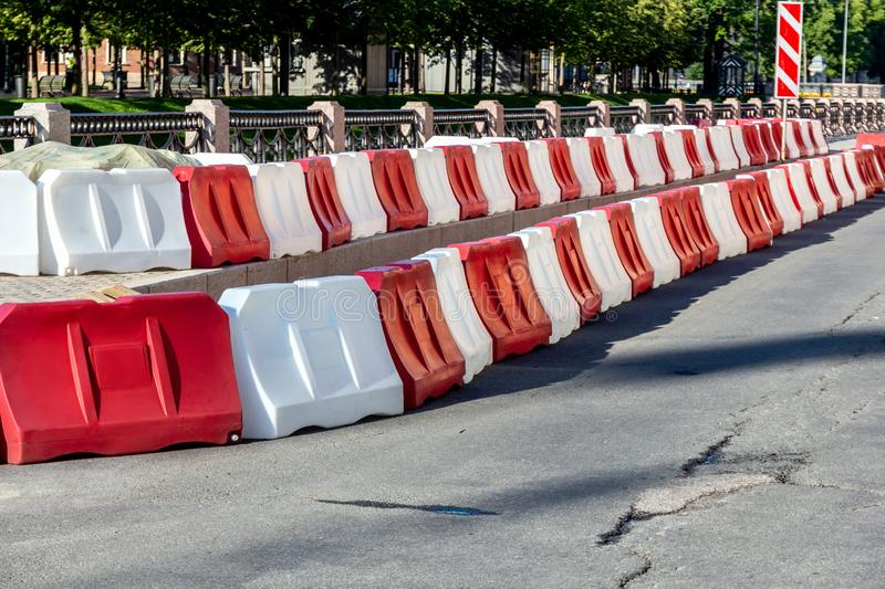 Plastic road fence on the street of the city. royalty free stock image
