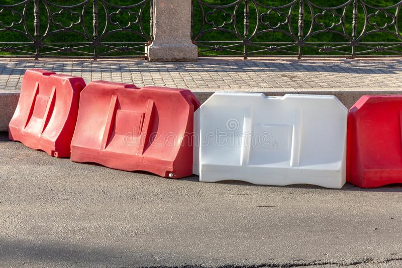 red and white water blocks to restrict traffic during road works royalty free stock images
