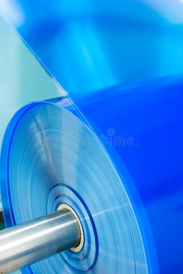 Plastic roll close-up. Packaging machine blue plastic roll close-up