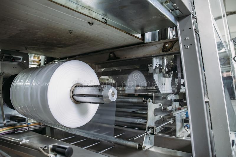 Plastic roll in industrial food packaging machine equipment tool at factory workshop royalty free stock image