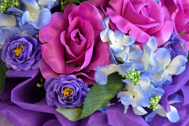 Plastic roses-beautiful colors of plastic flowers royalty free stock photos