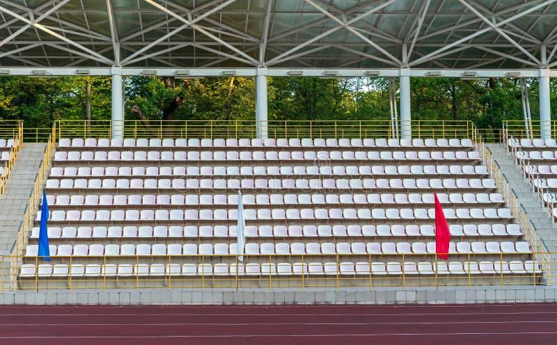 Plastic seats in the stadium. Tribune fans. Seats for spectators in the stadium.  stock photos