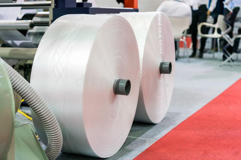 Plastic sheet roll on ground is raw material for publication industrial high technology and modern automatic machine stock photos
