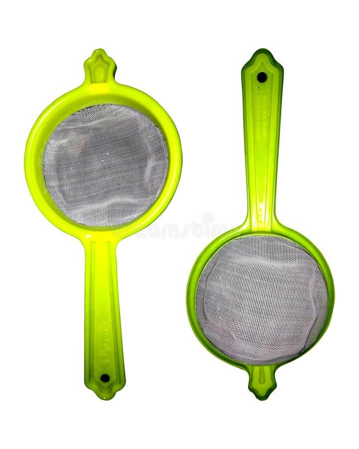 Plastic sieve. Plastic sieve with a handle.Orange plastic kitchen sieve on white background royalty free stock photos