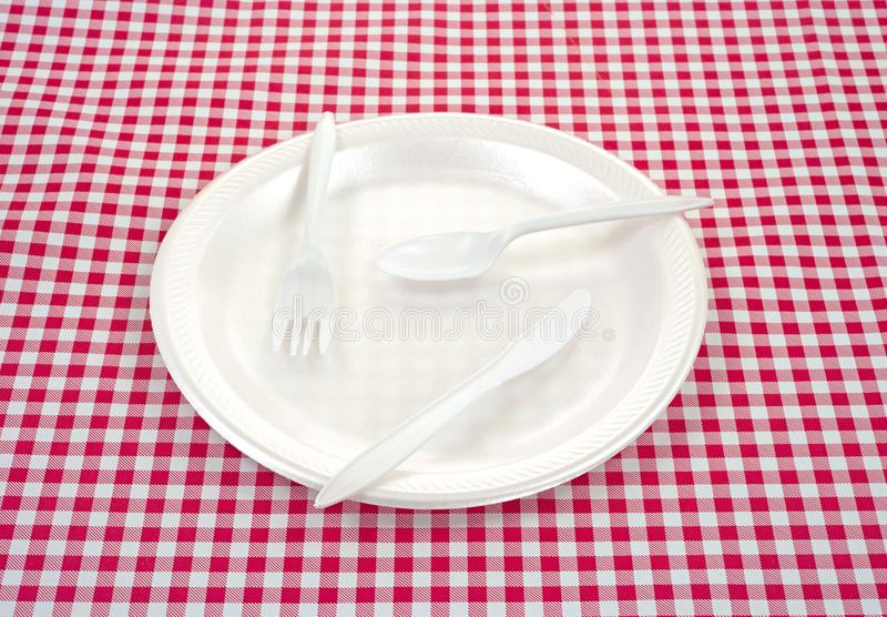 Plastic silverware on plate royalty free stock photos