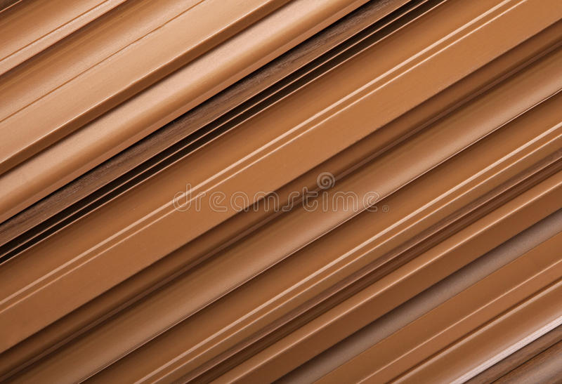 Plastic skirting-board. Close-up of New plastic skirting-board, background royalty free stock photography