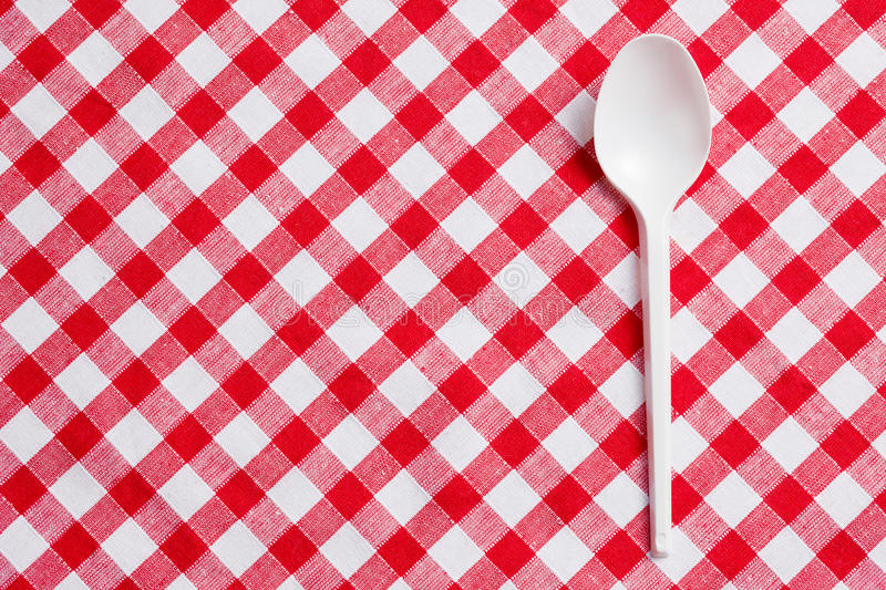 Download Plastic Spoon On Checkered Tablecloth Stock Photo - Image: 17679466
