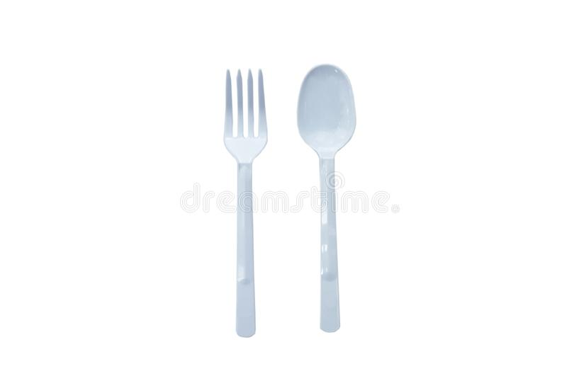 Plastic spoon and fork for single used on white background royalty free stock photos