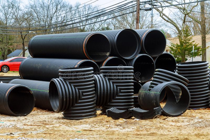 Plastic stacked PVC plastic industrial pipes. Plastic stacked PVC industrial pipes construction of housing project drainage canalization sewage sewer plumbing stock photo