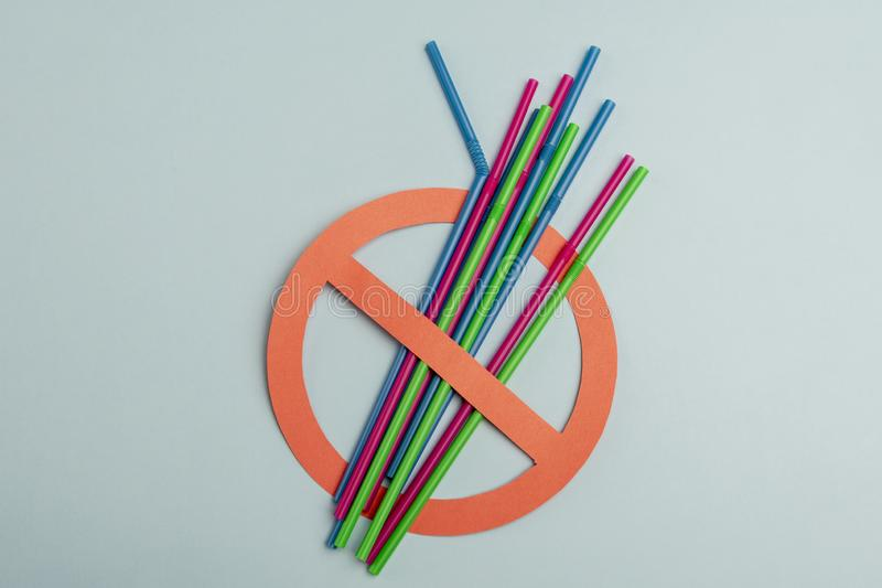 Plastic straws on light green background stock images