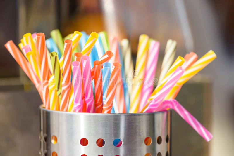 Plastic Straws In Metal Can. Colorful Plastic Straws In Metal Can royalty free stock photo