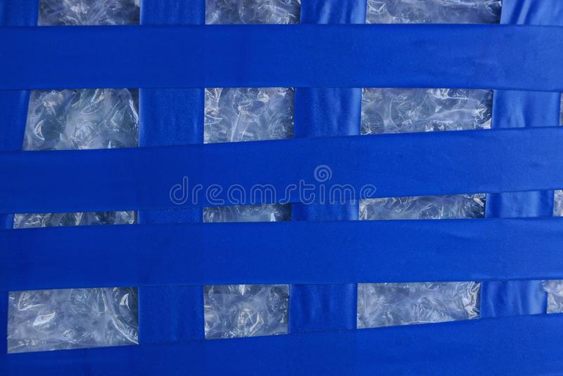 Plastic striped texture of blue electrical tape on white cellophane stock photos