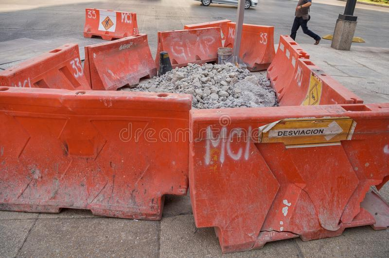 Plastic structures in orange color used as safety barriers during construction work. stock photo