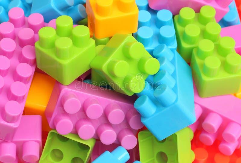 Plastic stuk speelgoed bouwstenen stock fotografie