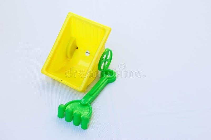 Plastic stuk speelgoed voor het strand van het kinderenspel op wit royalty-vrije stock foto